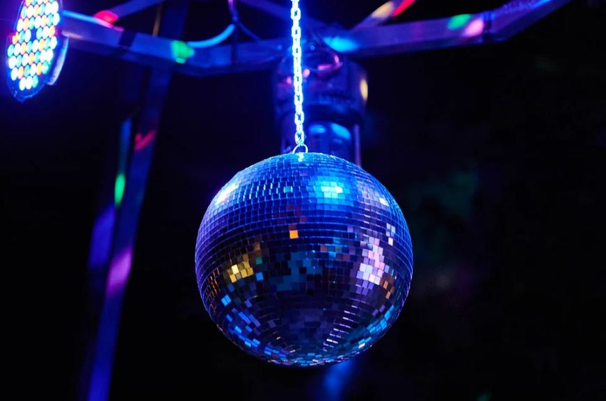 a lighted disco ball hanging from the ceiling